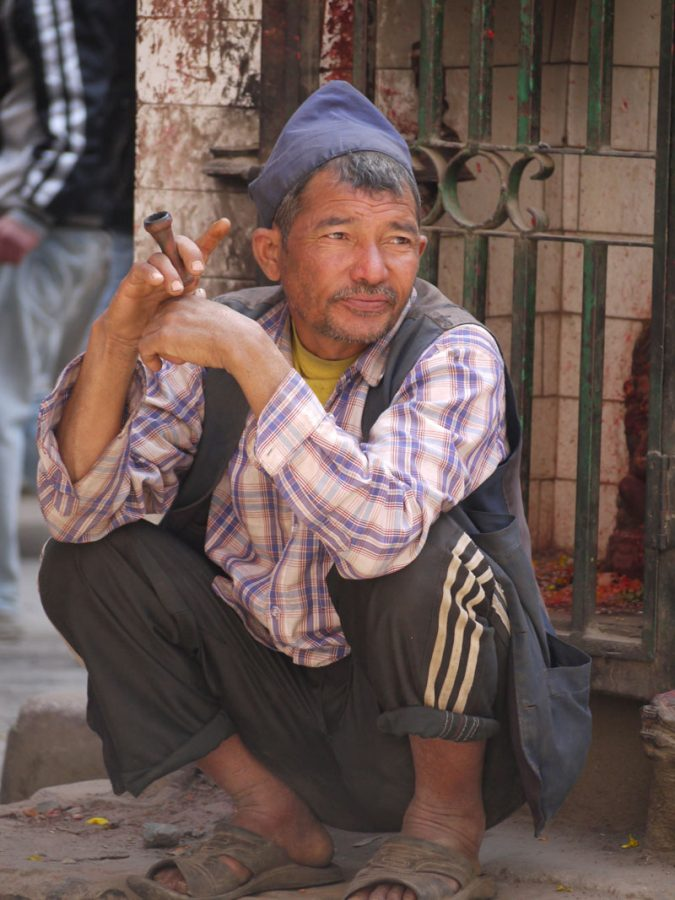 Local man smokes a chillum in downtown Kathmandu