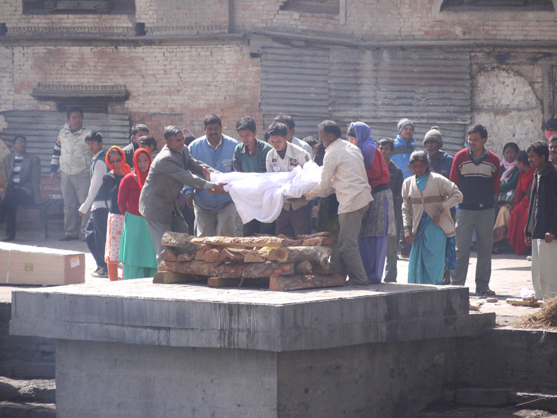 Body being brought forward by family members for cremation at Pashupatinath, Nepal