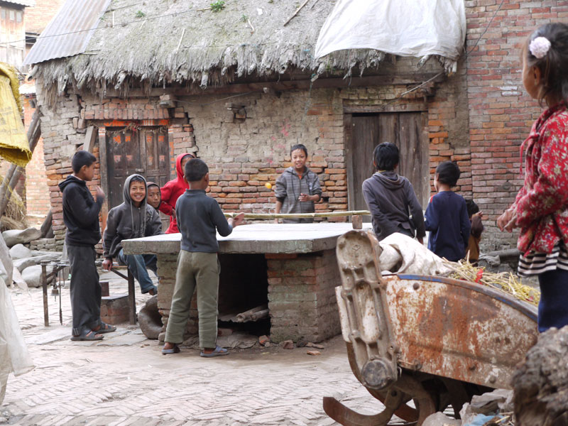 Kids play table tennis in the courtyards of Bhaktapur, Nepal
