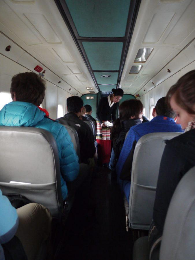 The air hostess hands out mints and cotton balls on our tiny aircraft, Nepal