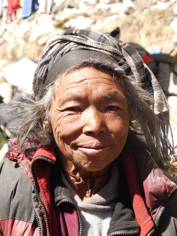 Friendly Sherpa woman, poses for a photo in Somare on the Everest Base Camp Trek
