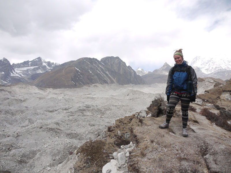 Noelle standing on the edge of the rocky Ngozumba Glacier er route to Gokyo Lake, Nepal