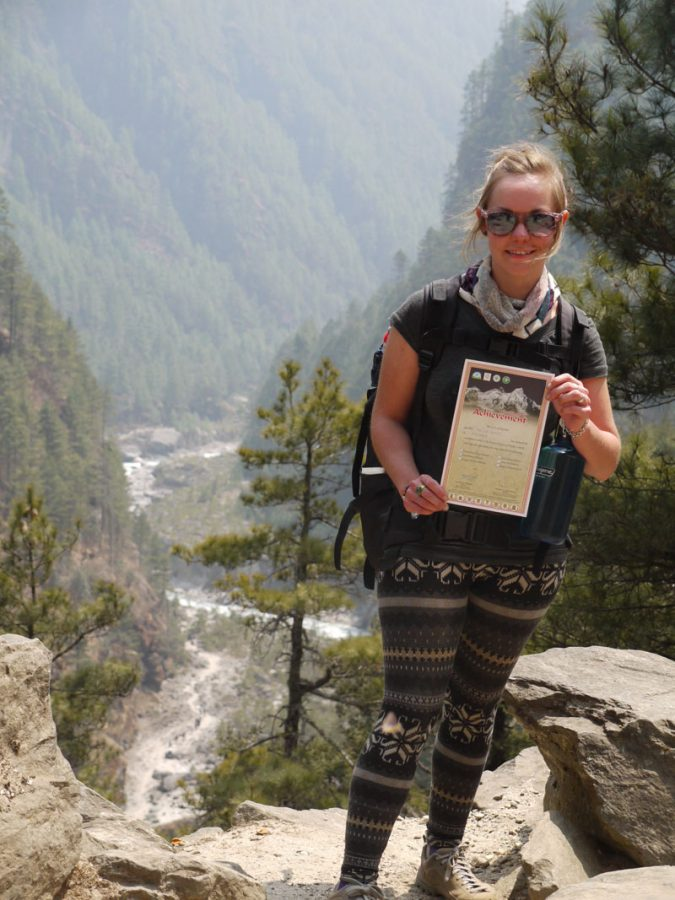 Noelle shows her certificate which we picked up just outside Namche Bazaar, on the way back down from the Everest Base Camp Trek