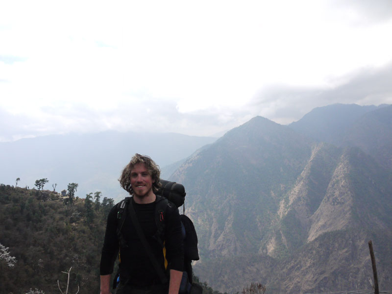 The sun comes out for a little while on the way down; Brian with the mountains behind him just outside Bupsa