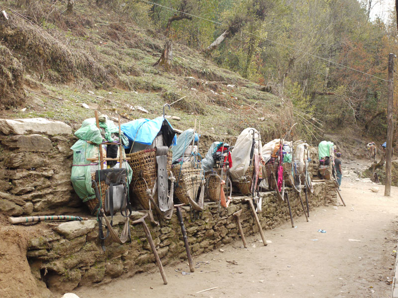 Porters leave their packs down while they stop for lunch en route to Karikhola