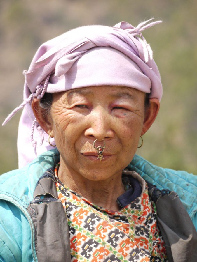 Local woman wearing nose jewellery in the Newari style in the village of Ringmu