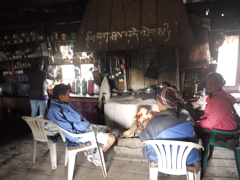 Having lunch with locals around the open fire at the top of the Lamjura La (Pass)