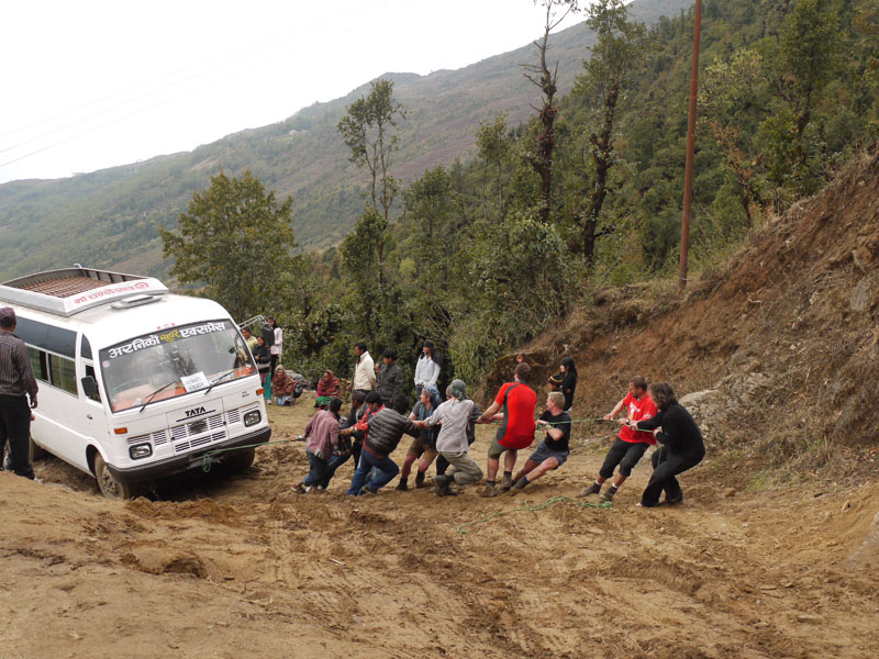 Pulling the bus up the hill in Bandhar but to no avail