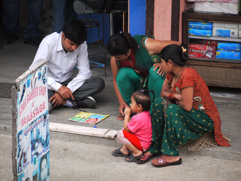 Family playing Ludo in Pokhara, Nepal