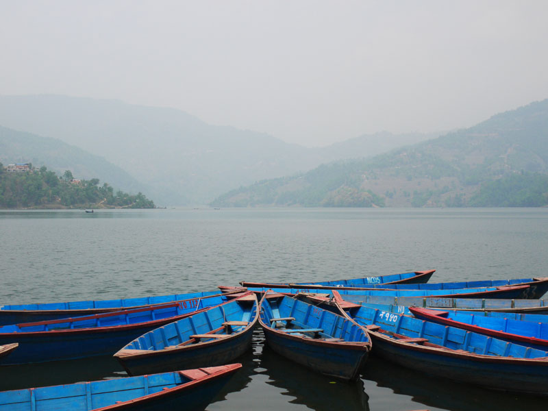 Row boats on Begnas Tal outside Pokhara, Nepal