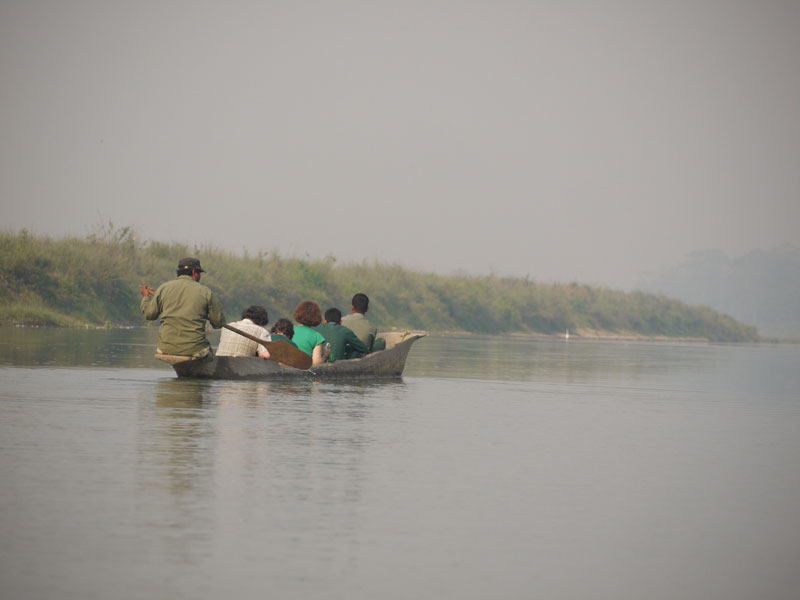 Cruising down the river in Chitwan Naional Parkat dawn in search of wildlife