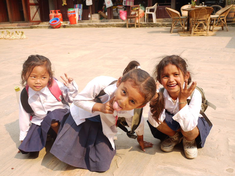 Happy excited school kids in Bandipur, Nepal