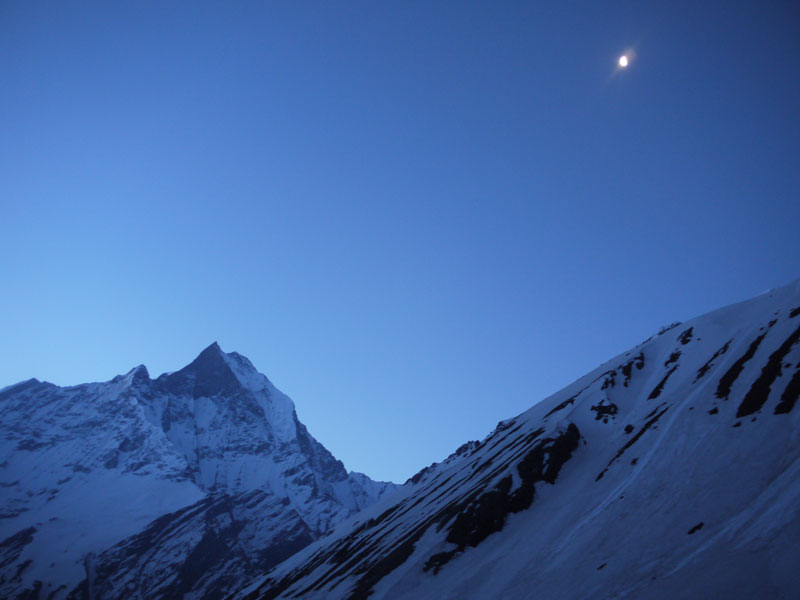 The moon shining in the clear sky as we hike towards the Annapurna Base Camp for sunrise