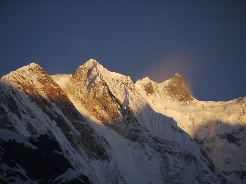 The peaks of the Annapurna Massif being illuminated by the rising sun on the morning of Day 7 of our trek to ABC