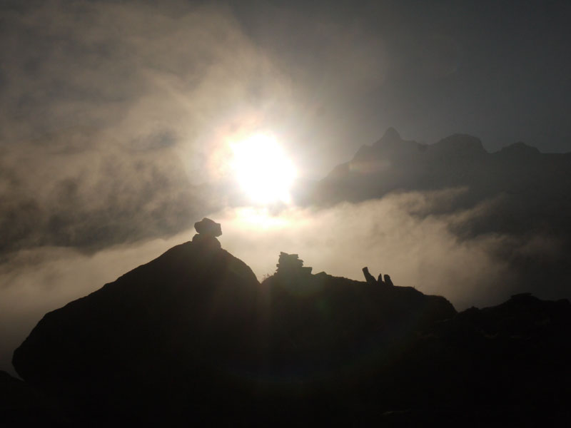 Sun rises high above the peaks of the Annapurna Sanctuary