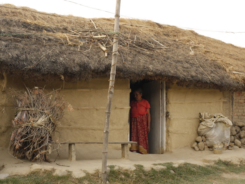 Traditional clay home with a thatched roof in Lumbini, Nepal