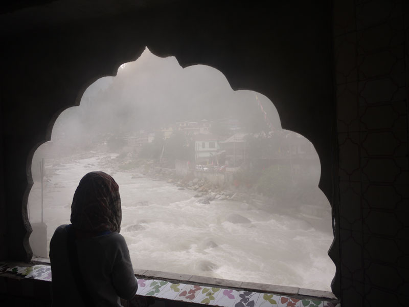 Noelle watcing the steam rising from the river at Manikaran