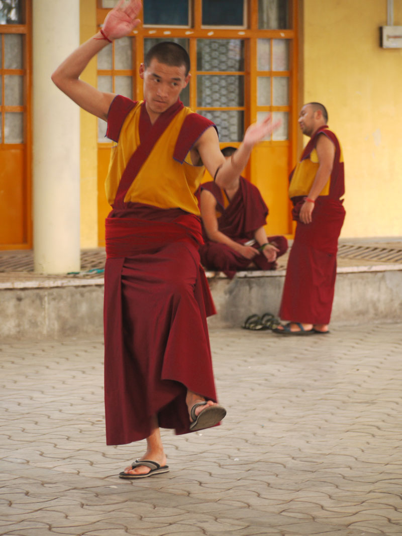 Young monk debating theatrically, McLeod Ganj