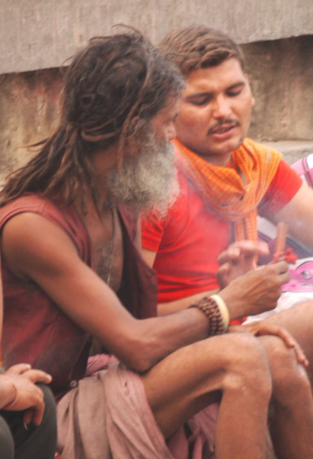 Saddhu and pilgrim sharing a chillum, Haridwar