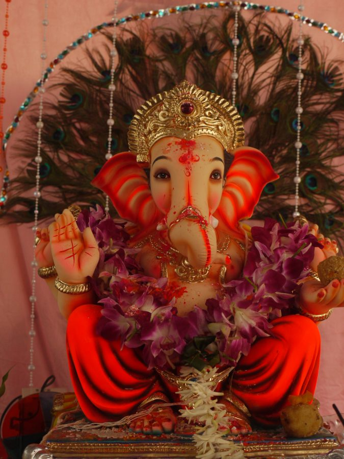 Ganesh Statue draped in garlands for Ganesh Chaturthi
