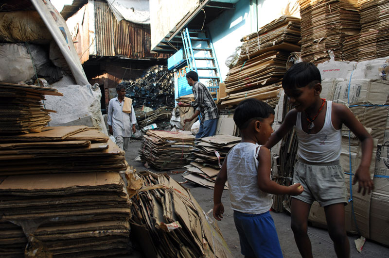 Kids playing among the recycled cardboard