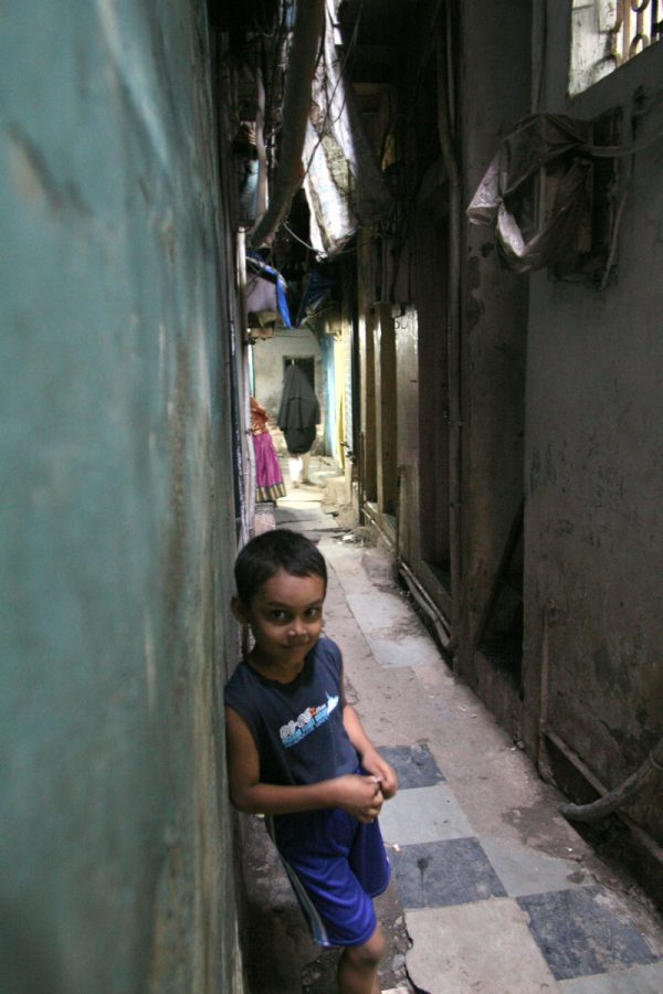 Cute kid on narrow streets in the residential sector