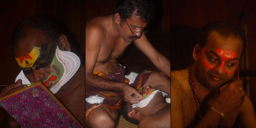 Performers applying their elaborate makeup before the traditional Kathakali performance.