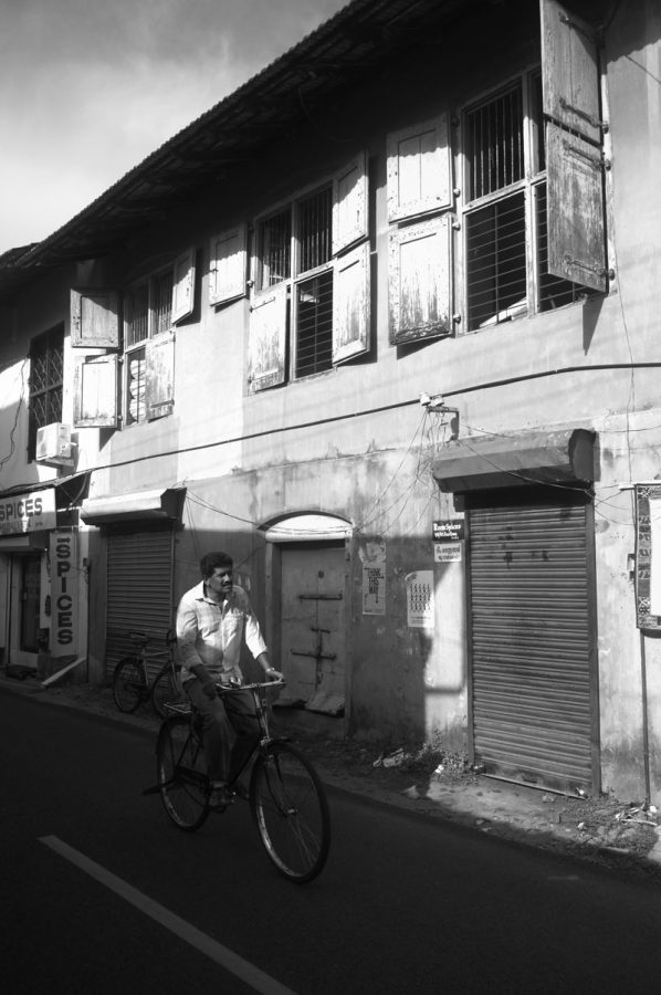 One man and his bike taking advantage of the near traffic free streets. Kochi, India