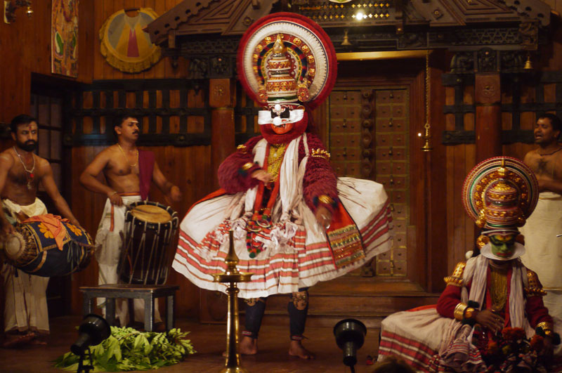 The story of good (green) versus evil (red) is one of the many stories told through the medium of Kathakali, Kerala, India