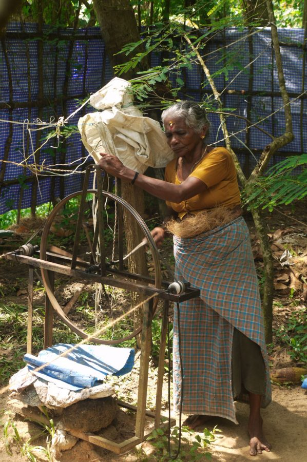 A local villager makes rope from coconut fibres, Kerala, India