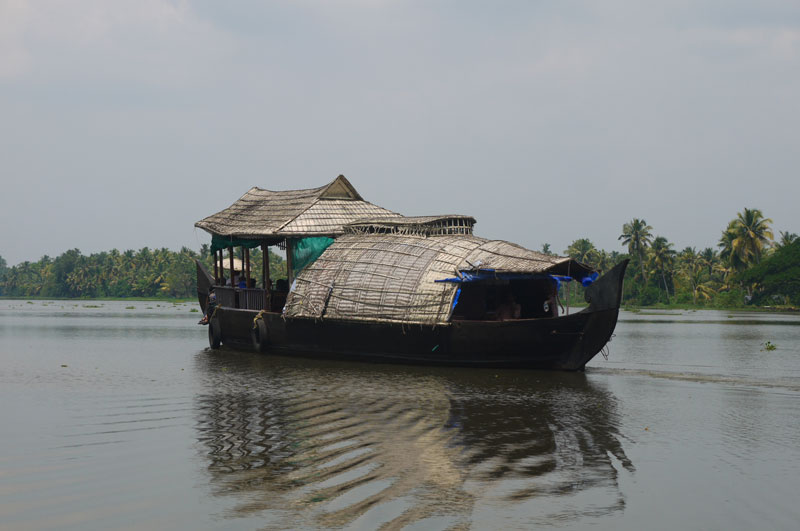 Covered boats like this can be seen along the backwaters, mainly used for transporting goods.