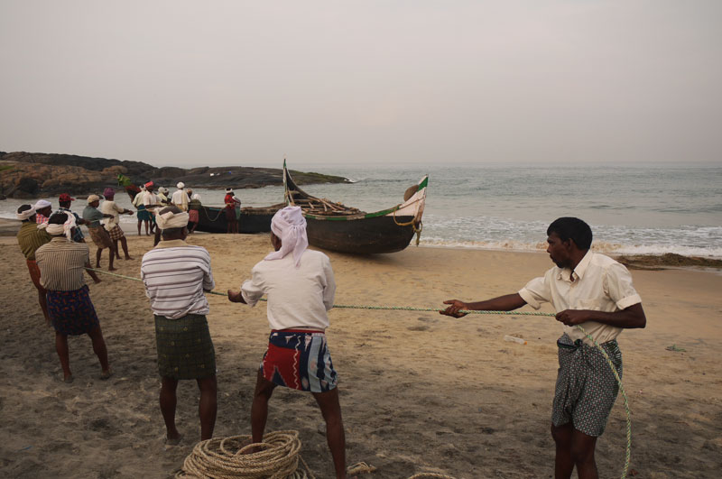 Fishermen hauling in their catch at dawn, Kovalam