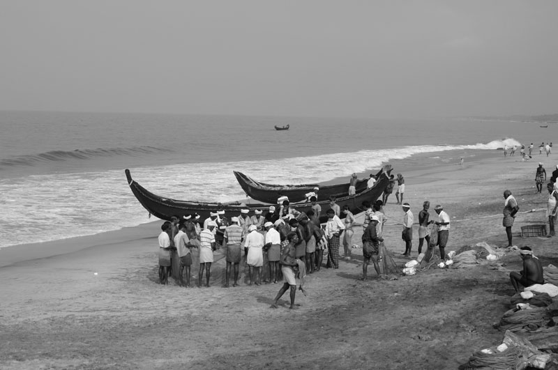 Fishermen congregating on the beach, Kovalam, India