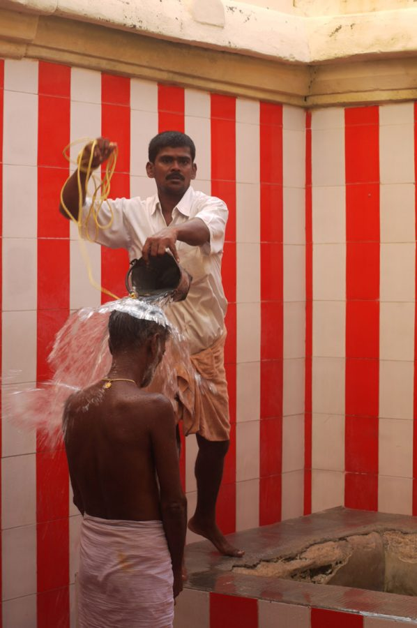 Pilgrim being doused in the holy waters of the Ramanathaswamy Temple