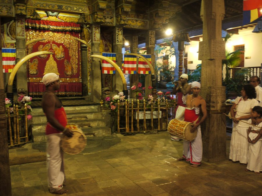 Puja begins inside the Temple Of The Sacred Tooth Relic, Kandy Sri Lanka