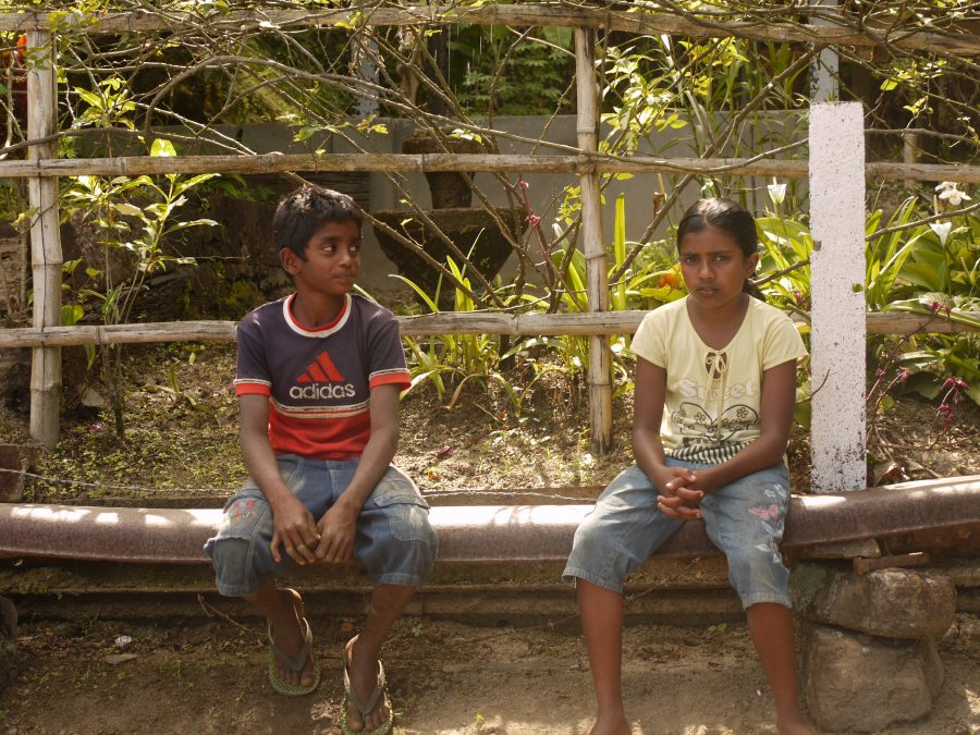 Kids hanging out watching the trains go by, Sri Lanka