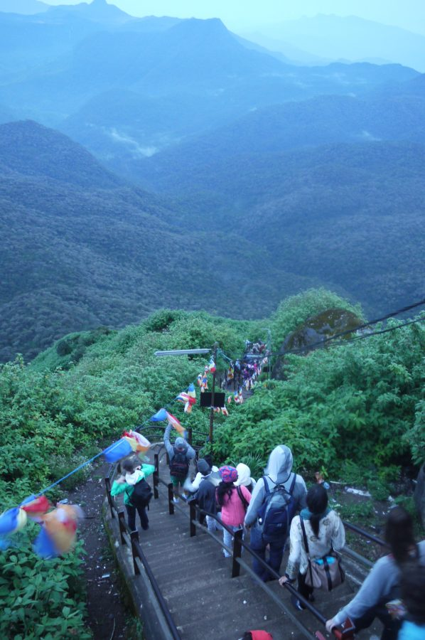 Hikers descending the steep stairs from the summit of Adam's Peak, Sri Lanka