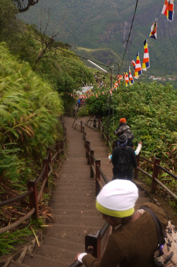 Steep stairs on the trail, lined with prayer flags, Adam's Peak, Sri Lanka