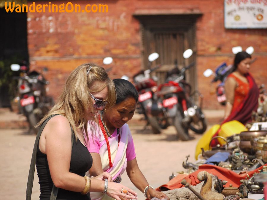 Noelle haggling with a Tibetan lady in the market in Durbar Square, Patan, Nepal