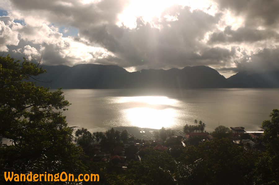 Sun breaks through the clouds over Lake Mininjau, West Sumatra, Indonesia