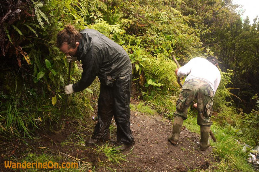 Brian and our guide Een clearing an area to camp at Shelter 3, Kerinci