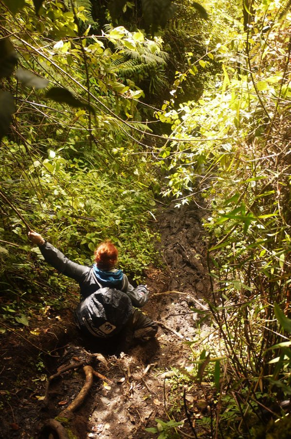 Noelle climbing down the tricky, steep and very slippy Kerinci trail