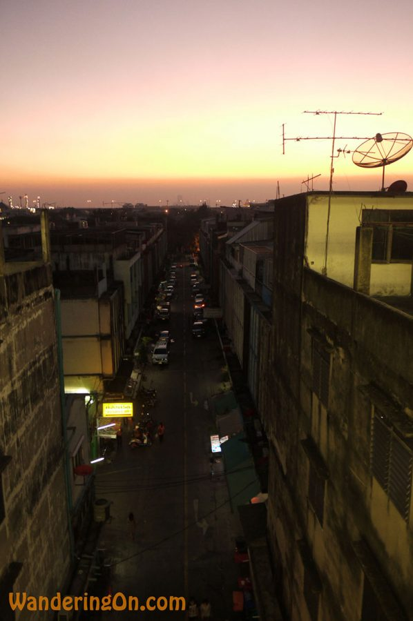 View down a street in Bangkok as dusk settles in