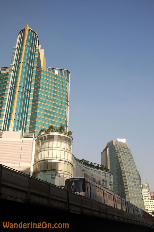 The Sky Train passes by Terminal 21 SShopping Mall in Bangkok, Thailand