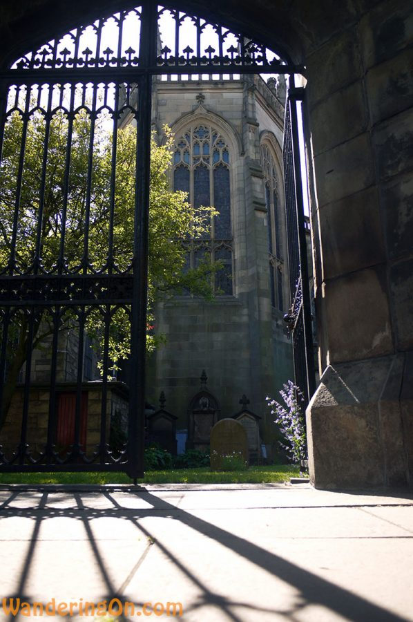 Sunlight creeping through the gate at St. John's Episcopal Church, Edinburgh