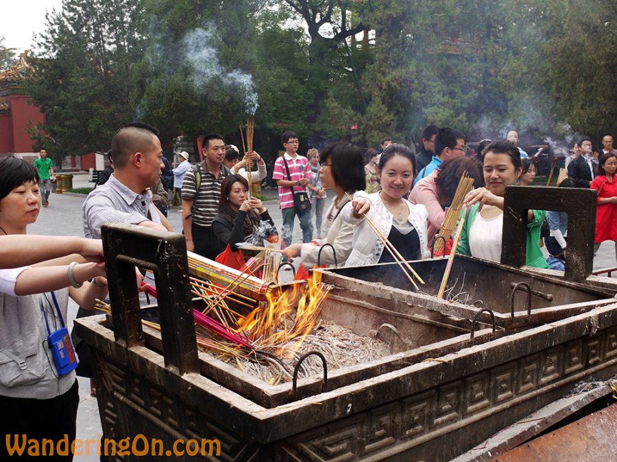Locals lighting incense outside the Lama Temple, Beijing