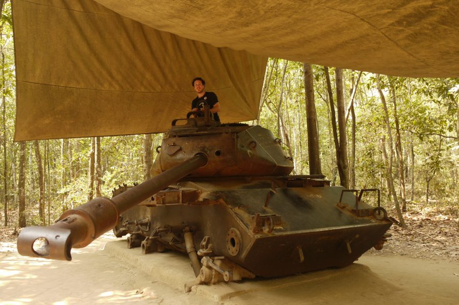 Brian with an old tank that was blown up during the fighting at the Chu Chi Tunnels