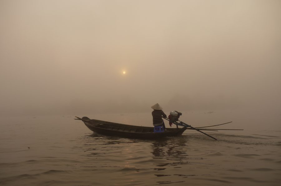 Cruising down the Mekong Delta in the morning mist at dawn