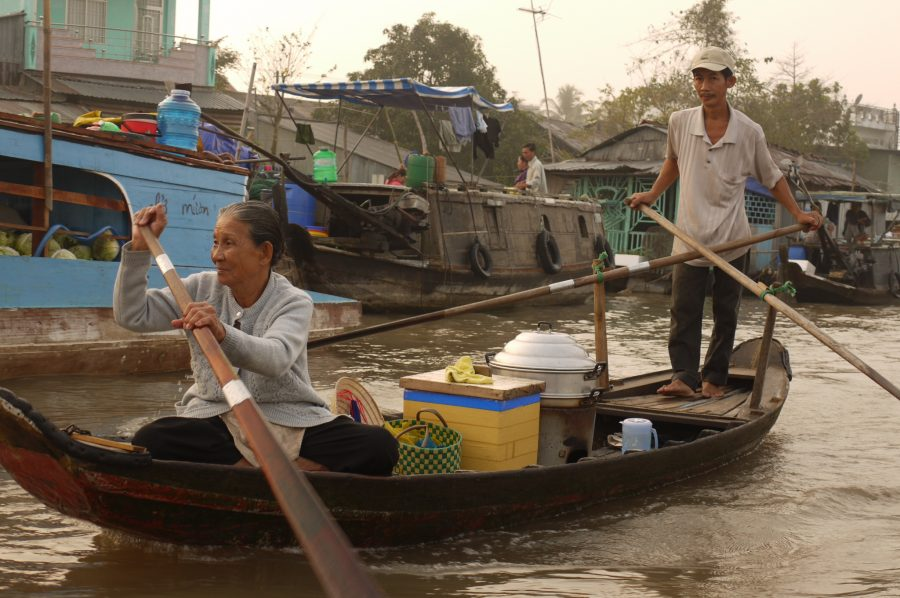 Husband and wife team making their way to the floating market on the Mekong Delta, Vietnam