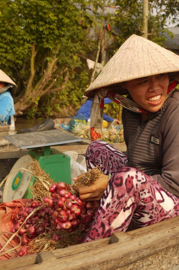 Woman selling shallots at the floating market